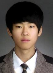 Choi Deok-Ha posing for 11th grade photo at Danwon High School